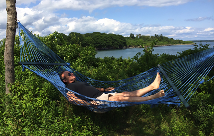 Judge Gary Flower relaxes on a hammock near a body of water