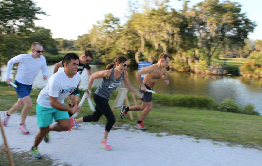 A group of runners starts a race outdoors