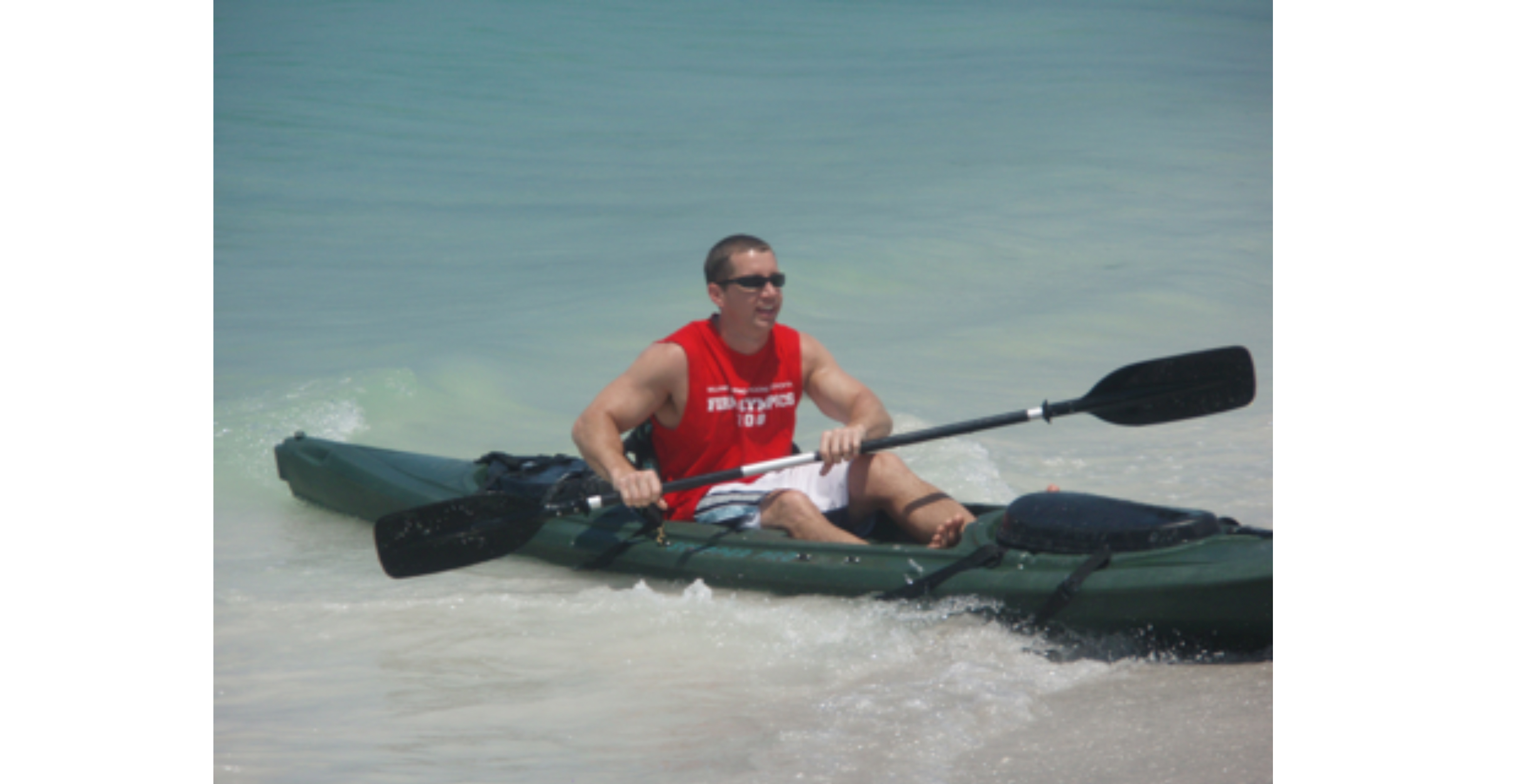 Daniel Dietric of Burr Forman is kayaking in open water