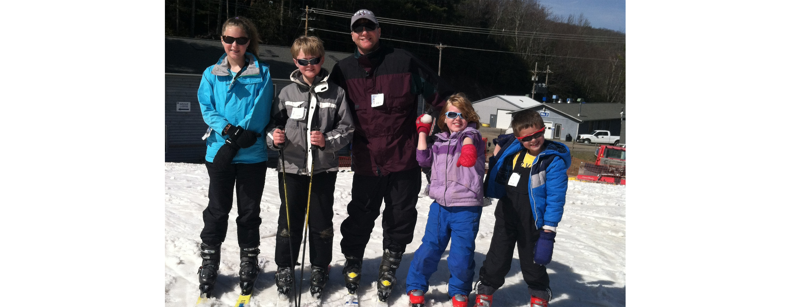 Judge Osterhaus is pictured with a group of children on a ski hill