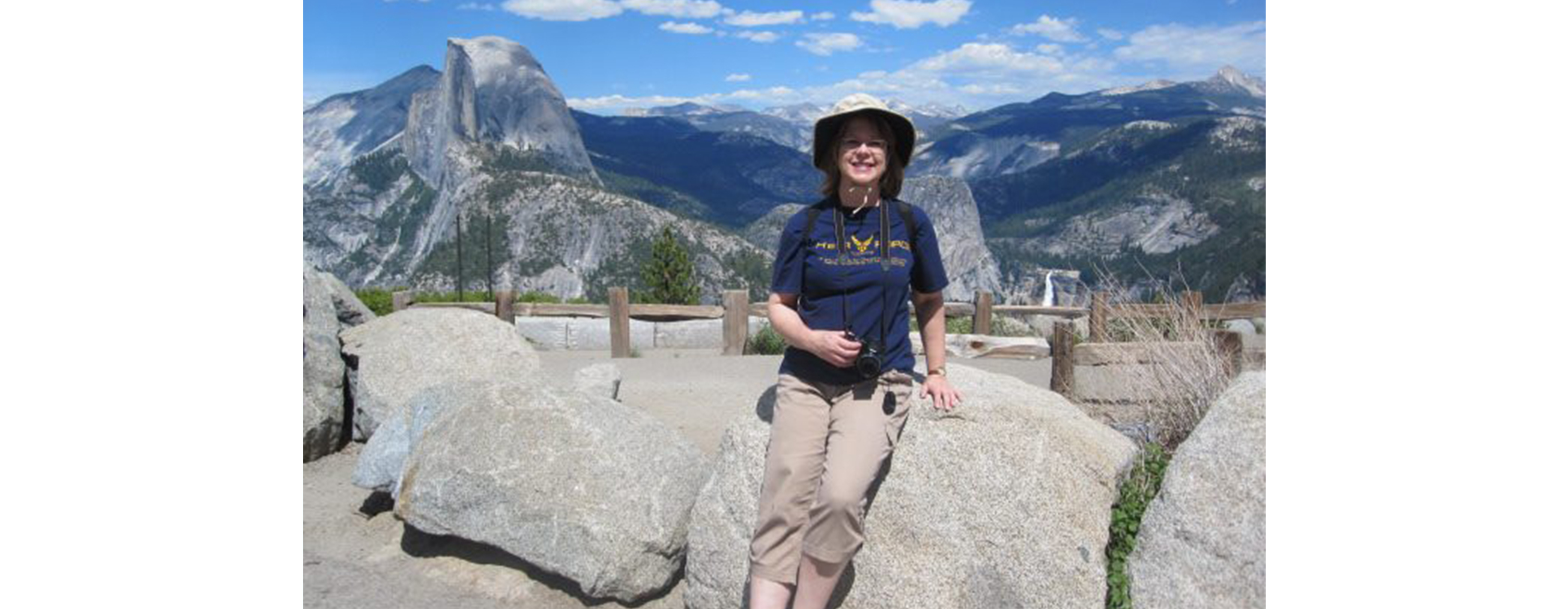 Judge Susan Kelseyis hiking in the mountains on a beautiful sunny day