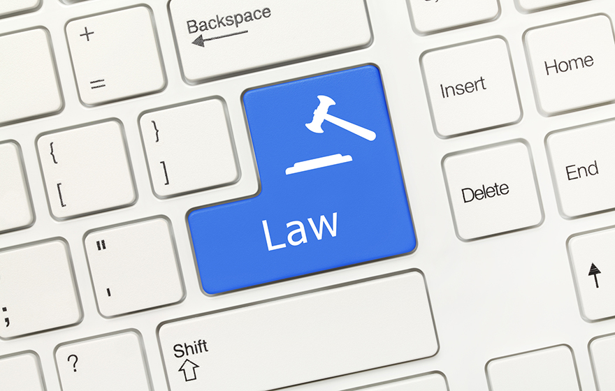 Close-up view on white conceptual keyboard - Law (blue key with gavel symbol)