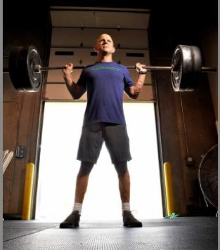 Bill Adams with barbell and weights
