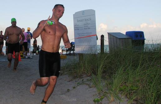 John Miller running near the beach