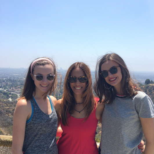 Michelle Suskauer pictured with 2 girls