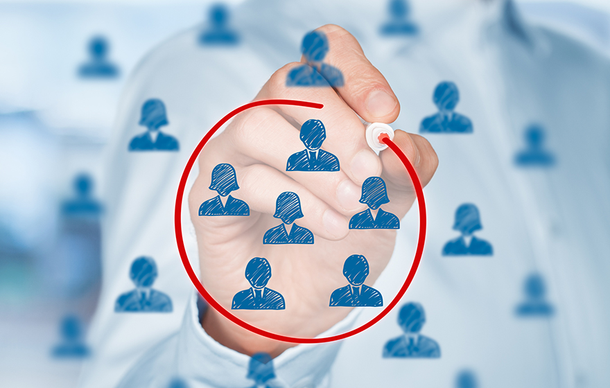 Segmentation Concept. Blue people icons on a white board with a professional person circling a segment of those people with a red marker