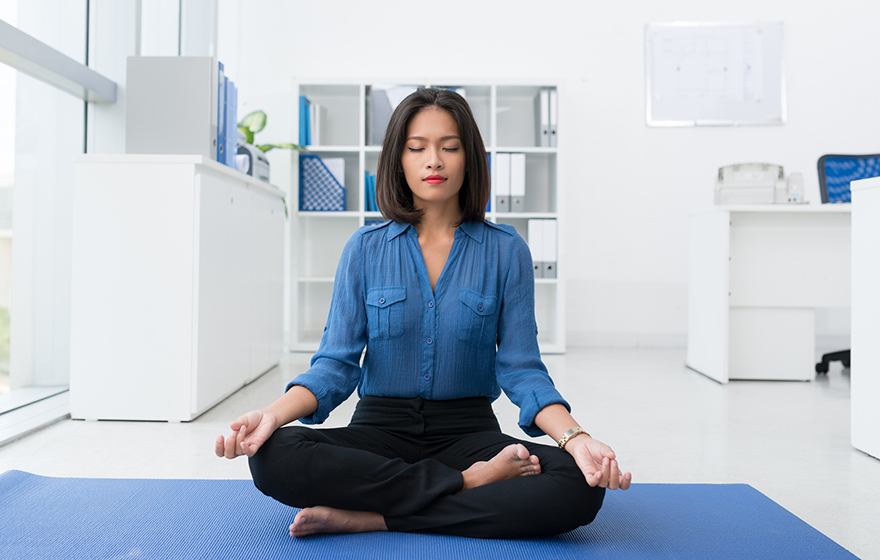 FLAYLD young Asian woman doing yoga in white office setting on blue mat