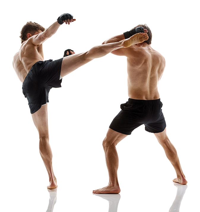 Two men doing mixed martial arts, Caucasian men in black shorts, kicking, muscular build, training gloves