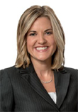 Jodi M. Ruberg headshot, Caucasian Woman in a black blazer and a white blouse, smiling, medium length blonde hair