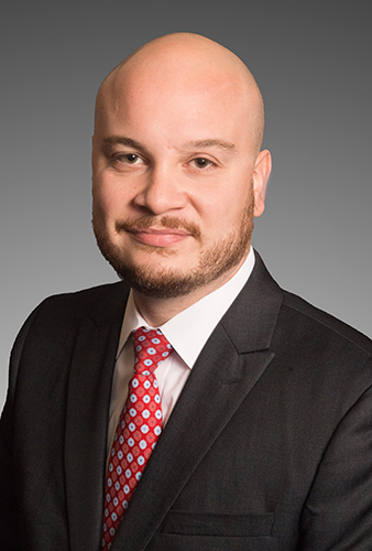 Santo DiGangi headshot, Caucasian Man in a black suit with red tie and white shirt, brown eyes, beard, bald